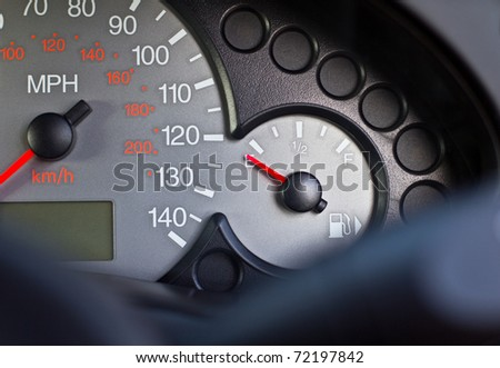 Drivers view of empty fuel tank on car dashboard - stock photo