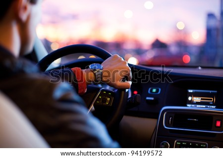 Driving a car at night - stock photo