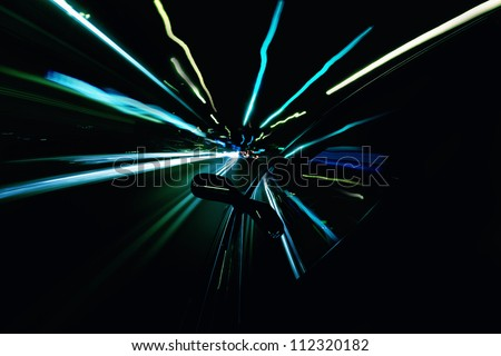 Driving a car at night. Motion blur. - stock photo