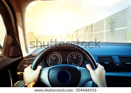 Driving a car - first person shoot - stock photo
