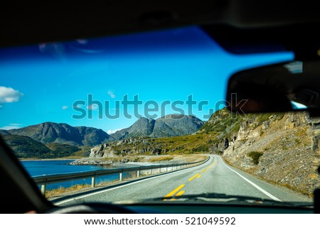 Driving a car on mountain road. Nature Norway. Polar circle. The way to Nordkapp