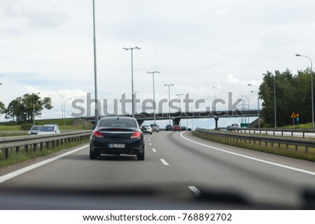 Driving a car on the highway in good weather conditions