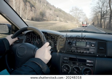 Driving a car through the coutryside - stock photo