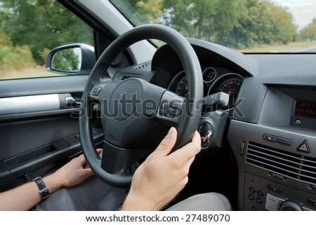 Driving a car viewed from inside - stock photo