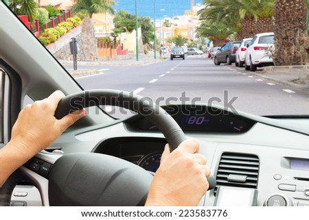 driving a caron town street, view  inside out, - stock photo