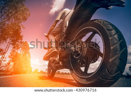 Driving a motorcycle in a sunny day. - stock photo