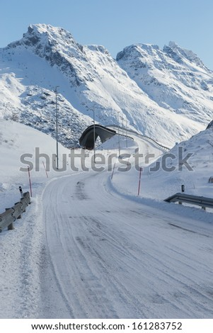 driving along norway highway during winter time - stock photo