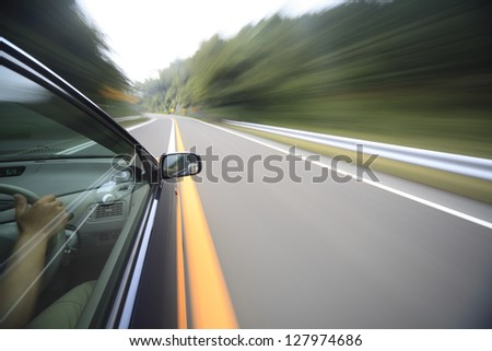 Driving at mountain road - stock photo
