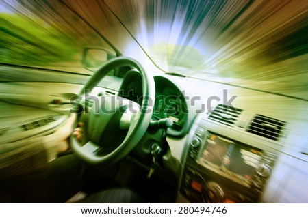 Driving car on empty road - stock photo