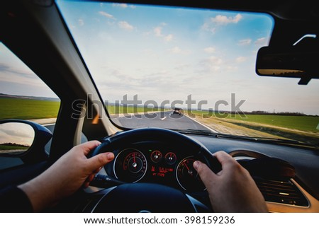 Driving car on the road, travel background. - stock photo