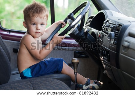 Driving child - stock photo