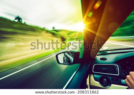 Driving Down the Road. Road to the Sun. Modern Car Driving.  - stock photo