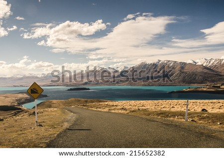 driving downhill road, warning sign - stock photo