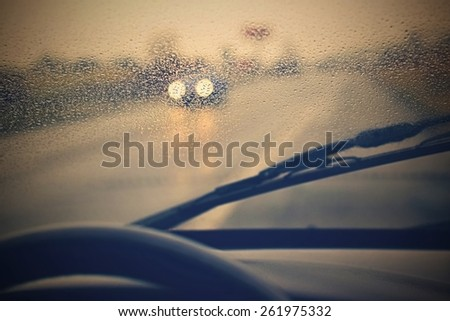 Driving from the driver's perspective in bad weather in the rain. - stock photo