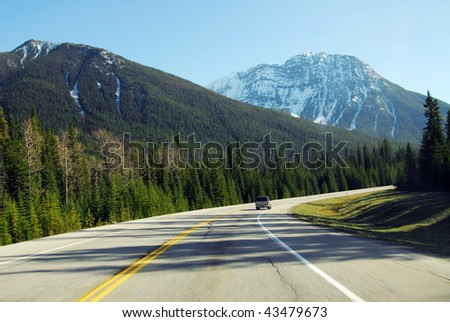 Driving in a scenic mountain road in kootenay national park, british columbia, canada - stock photo