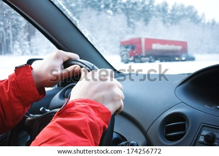 Driving in snowfall - stock photo