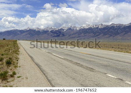 Driving in the Rocky Mountains - stock photo
