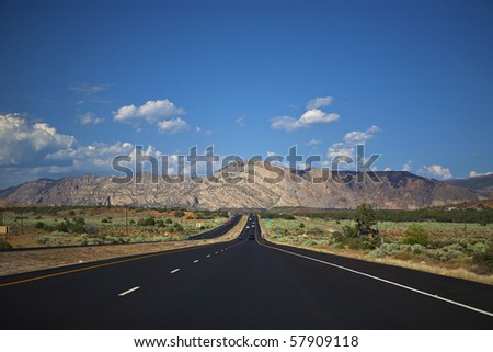 Driving on a good road through the wide open spaces of the western United States - stock photo