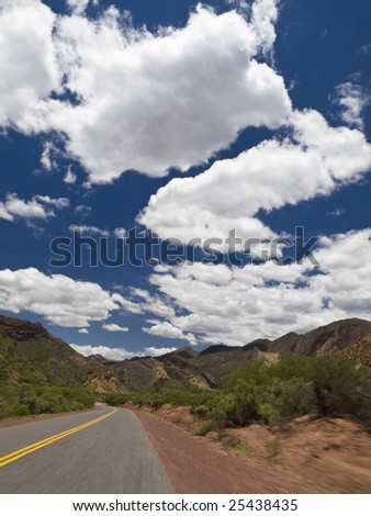 Driving on a road through a mountain landscape. - stock photo