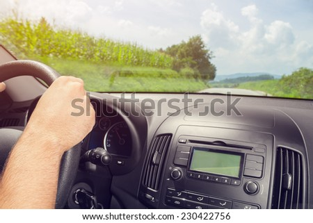 Driving on a suburb road. - stock photo