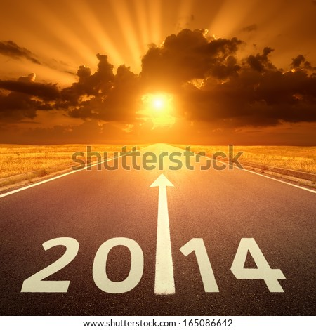 Driving on an empty asphalt road at sunset to new year - stock photo