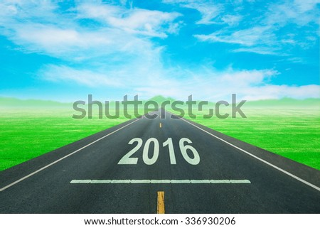 Driving on an empty road to upcoming 2016 new year - stock photo