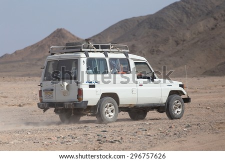Driving on jeeps on the desert  July 6, 2015 in Marsa Alam, Egypt - stock photo