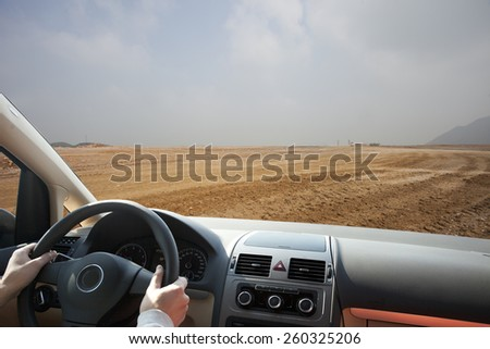 driving on mud road in day - stock photo