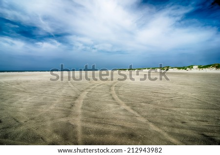 driving on sandy beach at outer banks cape hatteras north carolina - stock photo