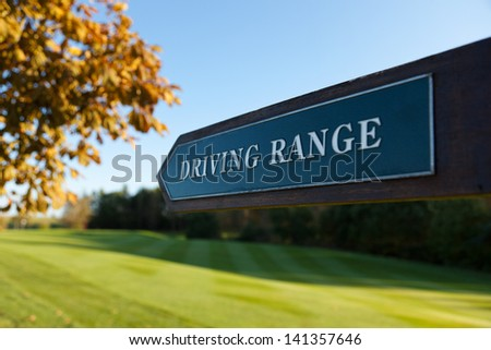 Driving Range direction sign at a golf course - stock photo