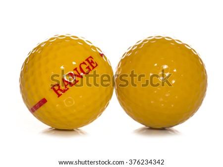 driving range golf ball studio cutout - stock photo