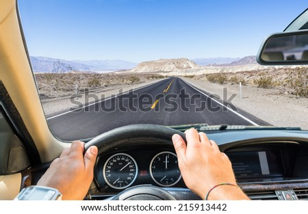 driving the car in the desert - stock photo