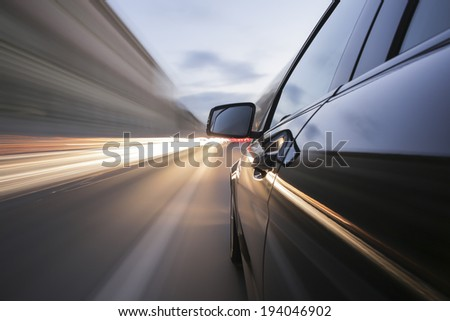 driving through Munich, during day, rigged camera on the side of a german black car, bulb exposure - time-lapse, special effects photography - stock photo