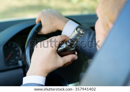 Driving under a drunken state - stock photo