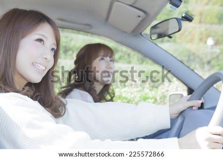 Driving women - stock photo