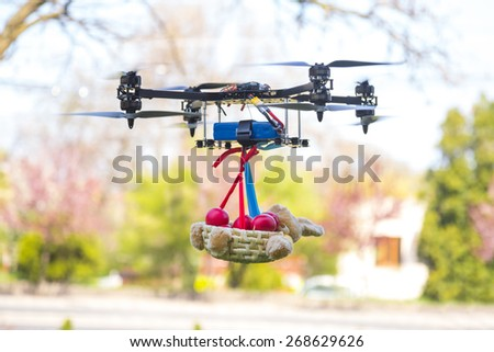 Drone carrying a basket with Easter red eggs - stock photo
