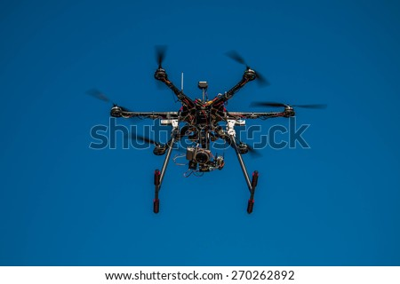 Drone flying in sky with camera attached