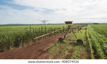 Drone monitoring a sugar cane field with pivot and some corn windrows - sunny day in Brazil - stock photo