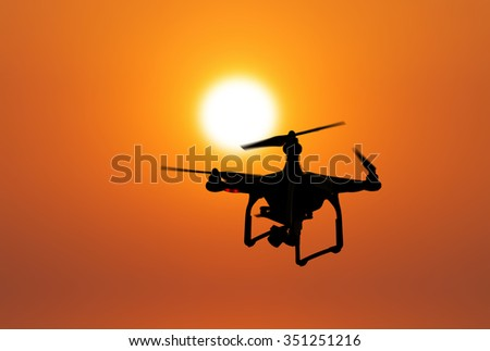Drone on sunset background