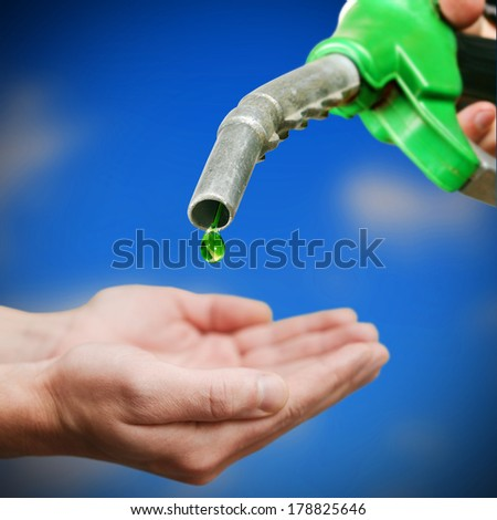 Drop of green fuel on Euro background - stock photo