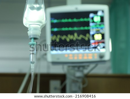 Drop of saline solution to help patient and medical monitors in a hospital. - stock photo
