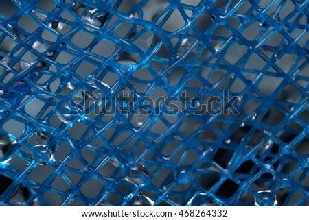 drop of water and blue net are beautiful when light passes them and refracts