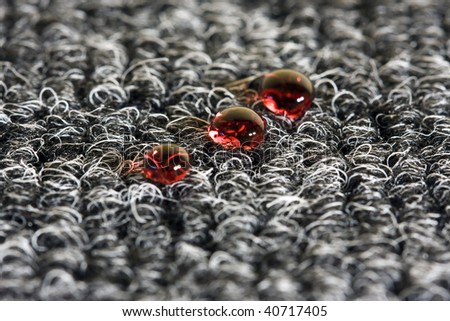 Drop of wine on the carpet - stock photo