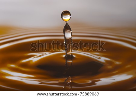 Drop splash with brown/yellow color - stock photo