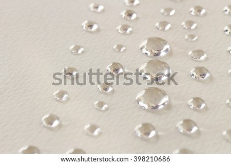 droplet close up on gray paper texture - stock photo