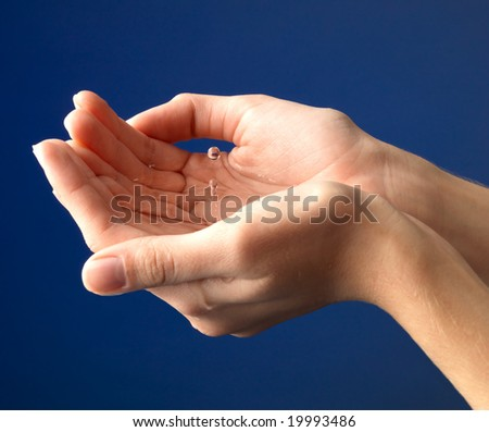 droplets flying out from hand - stock photo