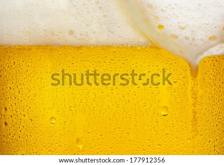 Droplets on freshly poured beer - stock photo