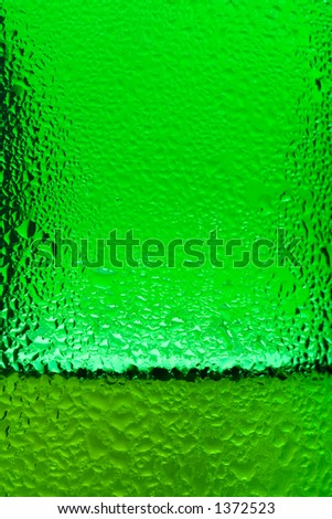Drops condensed on a bottle of beer - stock photo