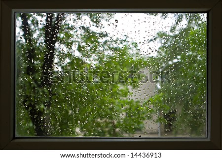 Drops of a rain on a window pane - stock photo