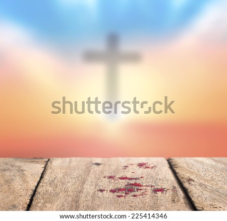 Drops of blood on old wooden floor over blurred the cross on a sunset. Thanksgiving, Christmas, Forgiveness, Repentance, Reconcile, Redemption, Redeemer, Love, Eucharist concept. - stock photo